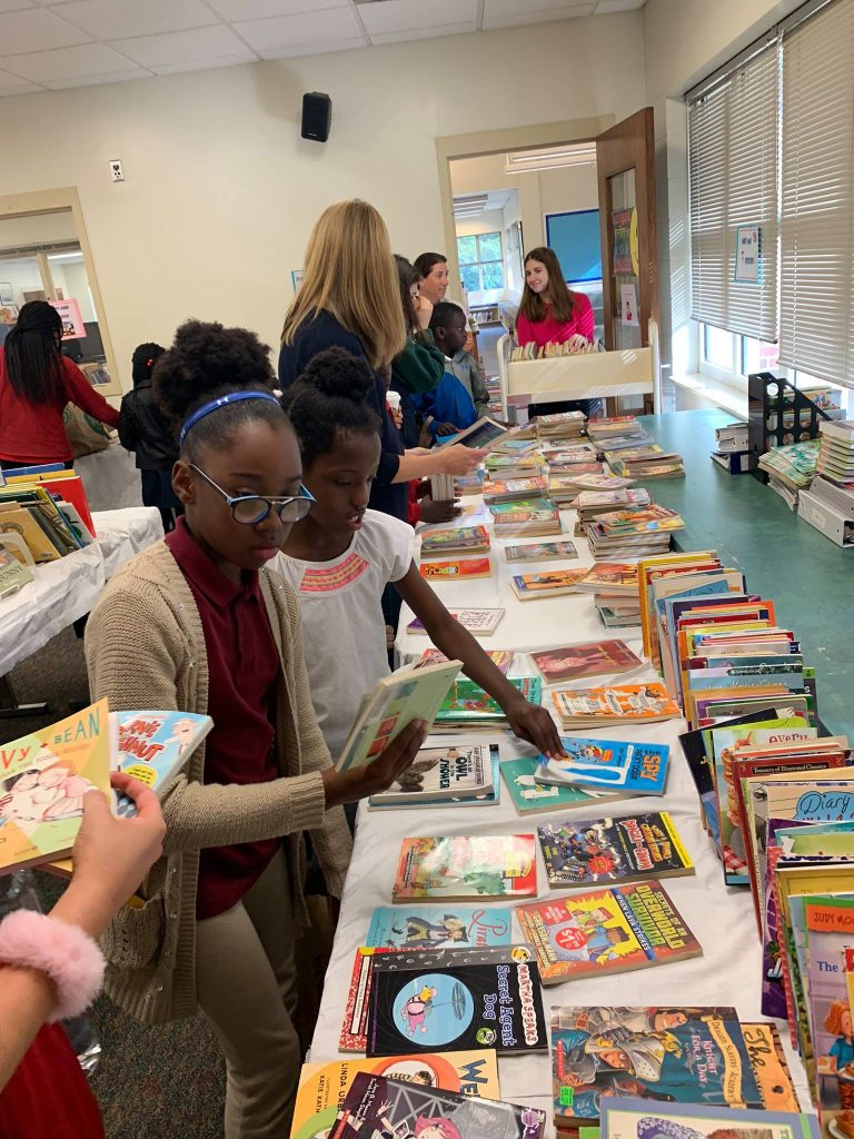 Bridges Students Participate in Gilman School Book Swap. Photo courtesy of Bridges Baltimore Facebook Page.