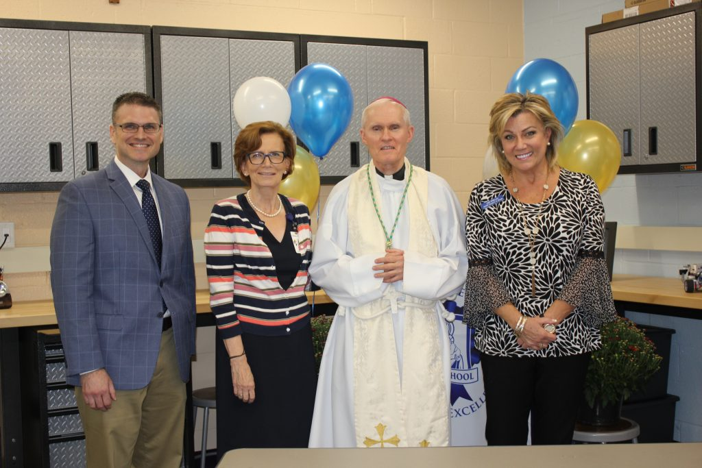 Dr. Pellechia, Dr. Hargens, Bishop Brennan, and Jodi Phelan smile at OLPH's Makerspace Engineering Lab dedication. Photo provided by OLPH.