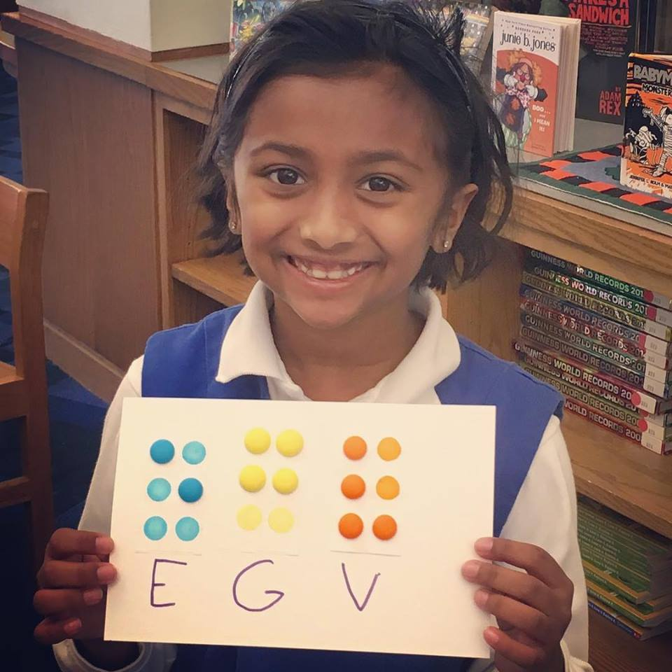 Roland Park Country School Students learn about braille. Photo courtesy of RPCS Facebook page.