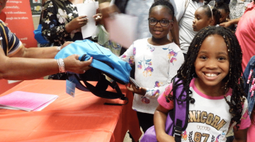 Partners in Excellence Backpack Distribution
